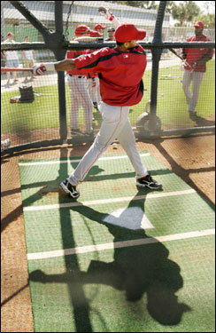 Juilo Lugo followed through on a swing during batting practice at spring training in Fort Myers on Tuesday.
