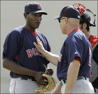 Red Sox pitcher Devern Hansack (left) is taken out of the game by coach Brad Mills (right) after giving up a two-run home run in the fourth inning against the Toronto Blue Jays Thursday in Dunedin, Fla.