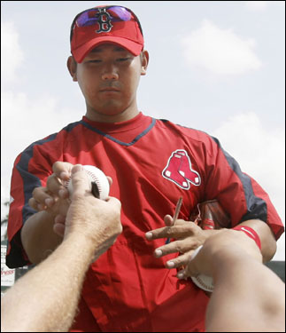 Red Sox pitcher Daisuke Matsuzaka signed autographs for fans before Thursday's game against Northeastern.
