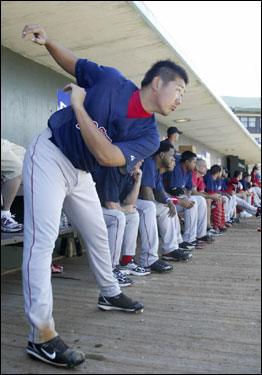 Matsuzaka loosened up in the dugout during the third inning.