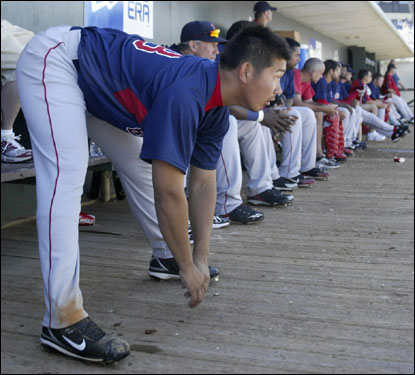 Daisuke Matsuzaka looked on from the dugout in the third inning.