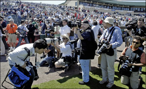 American and Japanese photographers took their positions to photograph Red Sox pitcher Daisuke Matsuzaka before his major-league debut in a spring training game Tuesday.