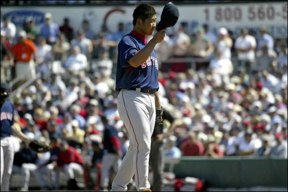 Red Sox pitcher Daisuke Matsuzaka tipped his cap as he stood on the mound during the second inning.