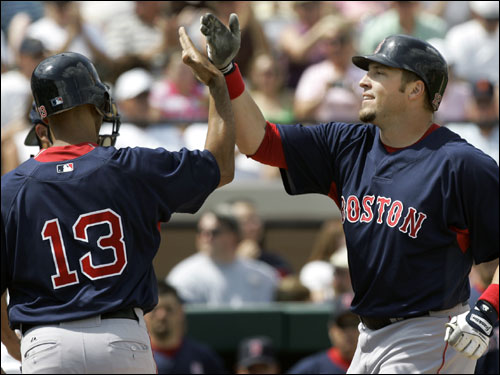 Red Sox's Eric Hinske (right) was congratulated by teammate Alex Cora after hitting a grand slam against Tigers pitcher Justin Verlander, during the first inning Saturday.