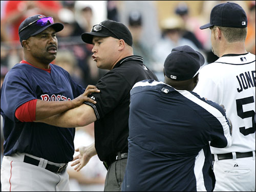 Red Sox third base coach DeMarlo Hale (left) was held back by first base umpire Marty Foster as Detroit Tigers hitting coach Lloyd McClendon held pitcher Todd Jones during a bench clearing in the fifth inning Saturday. Jones had been ejected from the game which sparked the bench clearing.