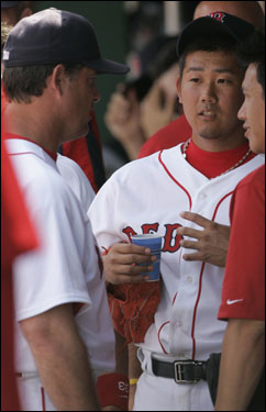 Matsuzaka spoke with pitching coach John Farrell (left) after completing his four-inning outing Sunday.
