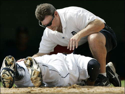 Detroit Tigers right fielder Magglio Ordonez was tended to by head trainer Kevin Rand after being hit in the head by a pitch from Red Sox pitcher Josh Beckett, during the third inning Saturday.
