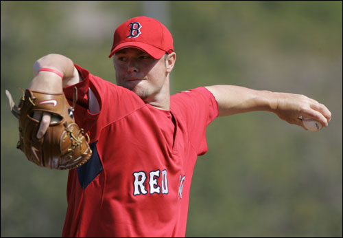 Red Sox pitcher Jon Lester delivered a pitch during a practice session in Fort Myers Sunday morning.