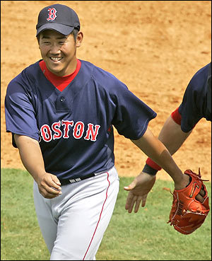 New Boston Red Sox pitcher Daisuke Matsuzaka, right, of Japan. Boston businesses are preparing for the surge of Japanese visitors that Dice-K's arrival could bring to the city.