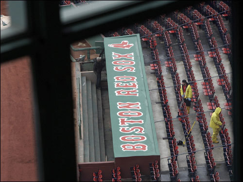 A view of workers working in the seating section is seen through the windows of media room at Fenway Park.