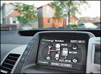 The dashboard computer monitors energy usage on a Toyota Prius hybrid.