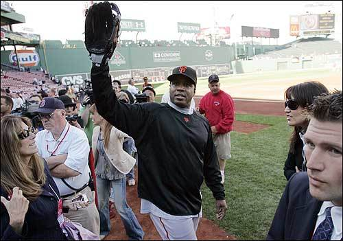 Bonds waved to the crowd at Fenway as he stepped onto the field.