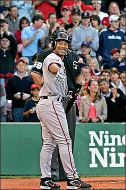 In stark contrast to the booing that Bonds received, former Red Sox outfielder Dave Roberts was greeted warmly in his return to Fenway. Known for his stolen base against the Yankees in Game 4 of the 2004 American League Championship Series, Roberts waved off the applause from his former teammates in Boston's dugout during a standing ovation in his first at bat.
