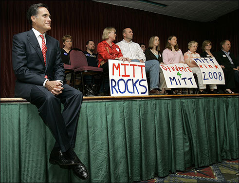 Romney sat on the stage as he was introduced to speak at a ''caucus coffee'' on May 9 in Clear Lake, Iowa.