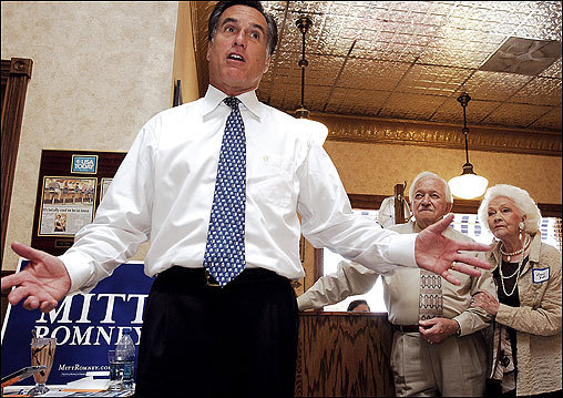 Romney made his campaign pitch as George and Loraine Wall, of Sioux City, Iowa, listened in the background during a stop at Wells Dairy's Blue Bunny Ice Cream Parlor, in LeMars, Iowa.