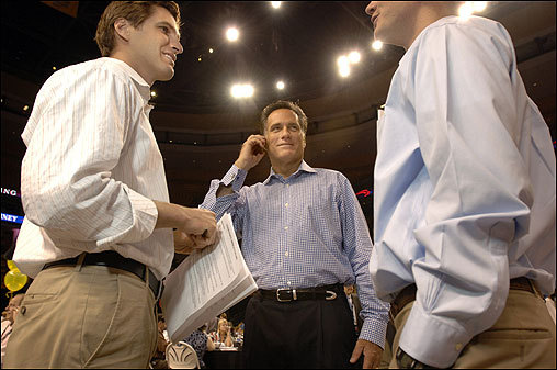Romney (center) spoke to a prospective donor on a cellphone as his son Josh (left) spoke with volunteer Richard Bennion at a campaign fund-raising call-center in Boston on June 25.