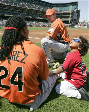 Manny Jr. is being Manny Jr., while his dad, Manny Ramirez (left), talks to Texas Rangers shortstop Michael Young during practice for the All-Star Game in San Francisco.