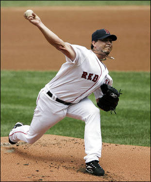 Red Sox pitcher Josh Beckett pitches against the Toronto Blue Jays during the first inning in at Fenway Park. Beckett was looking for his 13th win of the season.