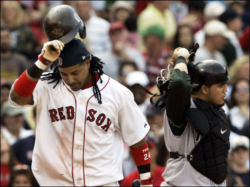 Manny Ramirez reacted as he struck out, leaving two on in the ninth inning, to end the game as Devil Rays catcher Dioner Navarro walked off the field at Fenway Park today.