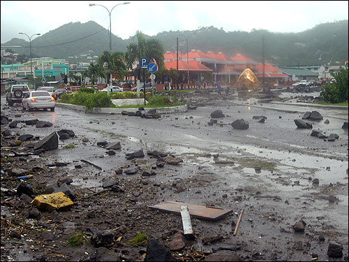 Debris covered the John Compton Highway in Castries, St. Lucia, after Hurricane Dean passed on Friday. Hurricane Dean, which at the time had claimed six lives, began sweeping past the Dominican Republic and Haiti and threatened to engulf Jamaica and the Cayman Islands.