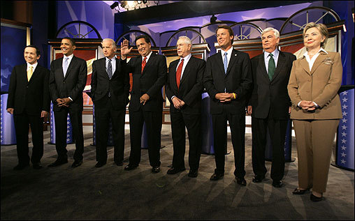 Democratic presidential hopefuls gathered on stage before the debate at Drake University in Des Moines on Sunday. From left, Representative Dennis Kucinich of Ohio, Senator Barack Obama of Illinois, Senator Joseph Biden of Delaware, Governor Bill Richardson of New Mexico, former senator Mike Gravel of Alaska, former senator John Edwards of North Carolina, Senator Chris Dodd of Connecticut, and Senator Hillary Clinton of New York.