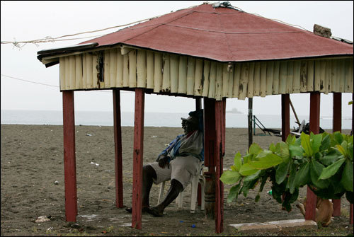 A man relaxes under a gazebo in the backyard of his sea front home at the coastal town of Port Royal, near Kingston, Jamaica, Sunday. Jamaica was preparing for a direct hit on Sunday by Hurricane Dean, storm that could rake the country with winds of 145 mph and dump up to 20 inches of rain.