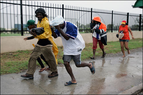 Jamaicans run toward a shelter in Kingston. Prime Minister Portia Simpson Miller urged residents to abandon their homes and head for shelter as the storm loomed offshore.