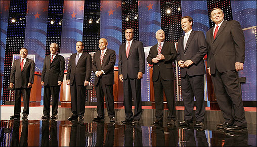 Eight of the nine Republican presidential candidates gathered for a 90-minute debate at the University of New Hampshire in Durham Thursday night. From left: Tom Tancredo, Ron Paul, Mike Huckabee, Rudy Giuliani, Mitt Romney, John McCain, Sam Brownback, and Duncan Hunter.
