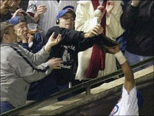 Vinik's catch had the opposite effect on the Red Sox than Steve Bartman's play on a foul ball did on the Cubs four years ago. In this October 14, 2003 photo, Cubs left fielder Moises Alou reached into the stands unsuccessfully for a foul ball tipped by fan Steve Bartman against the Marlins in the eighth inning during Game 6 of the NLDS at Wrigley Field. The Marlins won the series and went on to beat the Yankees in the World Series.