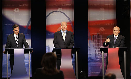 Republican presidential hopefuls Mitt Romney (left) and Rudy Giuliani (right) clashed over tax and spending cuts Tuesday, each claiming greater commitment than the other, as Fred Thompson (center) made his debate debut.