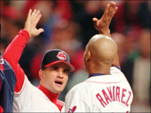 Cleveland Indians shortstop Omar Vizquel (left) exchanged high fives with teammate Manny Ramirez (check out the shaved head on Manny!) after their win over the Red Sox in Game 2 of the ALDS in Cleveland.