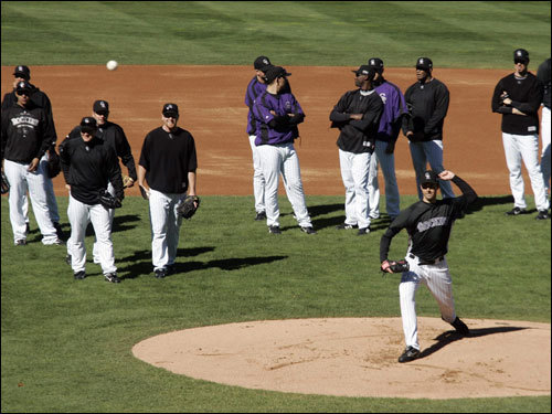 Colorado Rockies pitcher Jeff Francis (front right) ran through a drill while the other pitchers looked on during practice at Coors Field in Denver, on Monday.