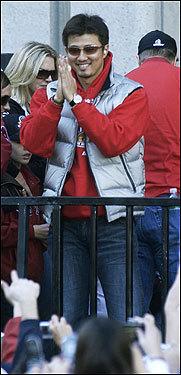 Pitcher Hideki Okajima bows to fans.