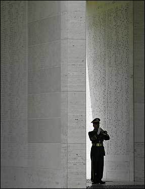 In the Philippines, a soldier played taps between walls engraved with the names of American soldiers killed during war, marking Veterans Day at the American Cemetery in suburban Taguig.