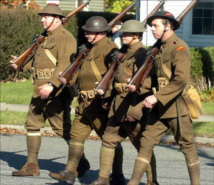 Dressed as World War I doughboys, (from left) John Torkos, Paul Van Eeckhoven, Alan Lowcher, and Andrew Drysdale marched in a Veterans Day parade in Belvidere, N.J., on Sunday.