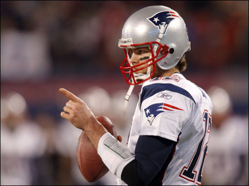 Tom Brady warmed up on the field prior to the game.