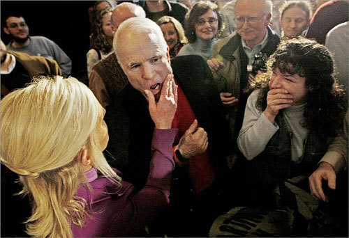 Cindy McCain (left) wiped lipstick off the cheek of her husband following a rally at Dartmouth College in Hanover, N.H.