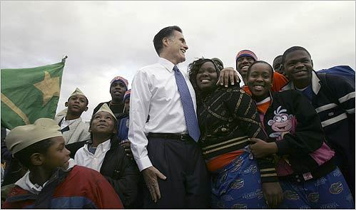 Mitt Romney stood with children before a Martin Luther King Jr. Day parade in Jacksonville, Fla.