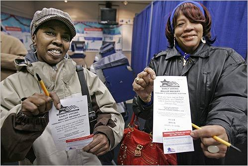 Merlyn Robinson (left) and Tequria A. Brown showed off their early voting receipts after casting their ballots in the Illinois primary on Martin Luther King Day during the Chicago Board of Election Commissioners grace period.