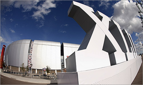 University of Phoenix Stadium, site of Super Bowl XLII, sat under partly cloudy skies Monday.