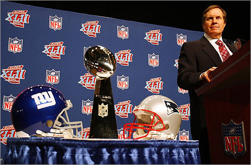 The Patriots coach did not pose with, or even glance at, the trophy during the press conference.