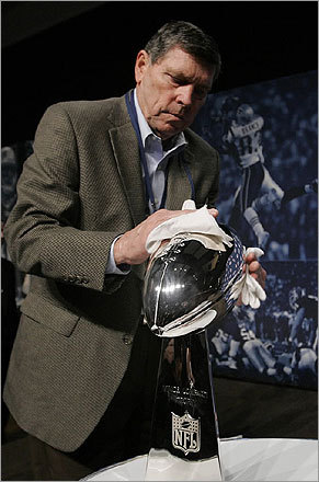 Ben Nix, a member of NFL security, wiped off the Lombardi Trophy before the final Super Bowl XLII news conference at the Phoenix Convention Center.