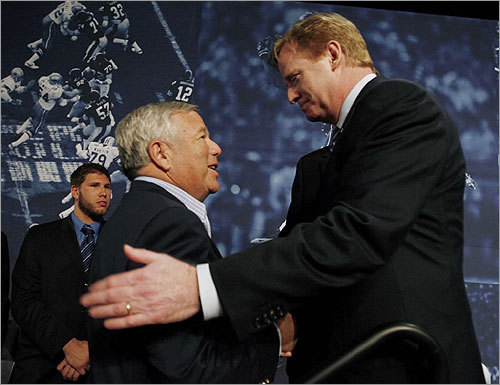 Roger Goodell (right) shook hands with Patriots owner Robert Kraft following a news conference.