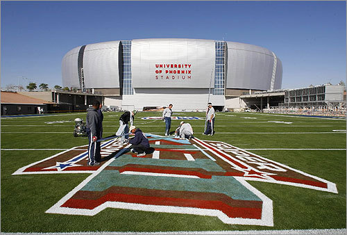 Workers prepared the field for Sunday's Super Bowl outside University of Phoenix Stadium. The retractable field was rolled back into the stadium after being worked on, where it will stay until the Super Bowl.