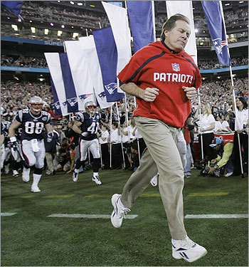 Patriots head coach Bill Belichick ditched his trademark gray sweatshirt for new red duds, as he ran onto the field before the game.