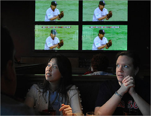 Doris Chin (left), of Medford, and Anne Devoy, of Somerville, watched the Red Sox at Game On.