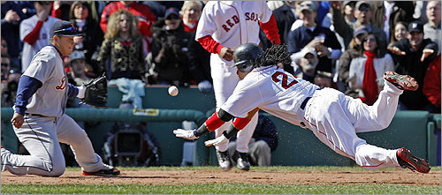 Manny Ramirez dove into third base on a triple as Miguel Cabrera lost the ball in the third inning. Ramirez took home on the error, putting the Red Sox up 2-0.