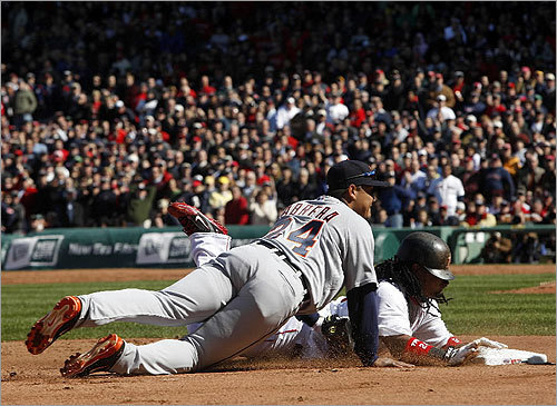 Miguel Cabrera watched the ball fly into the dugout as Manny Ramirez slid into third base.