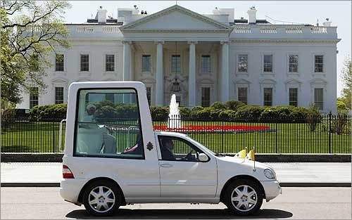 Pope Benedict XVI waved from the popemobile as he drove past the White House.