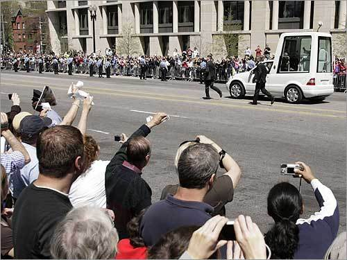 A crowd greeted Pope Benedict as he drove in the popemobile west on Pennsylvania Avenue.